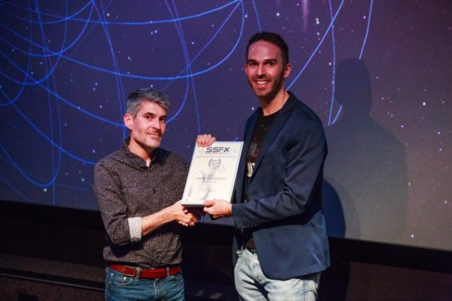 Simon Rattigan receives his certificate for 'Names and Numbers'