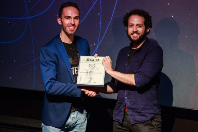 Adam Azmy receives his certificate for 'Murmurs of a Macrocosm'